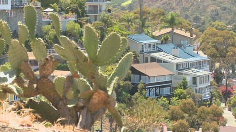 A house on a Southern California hillside features Footage
