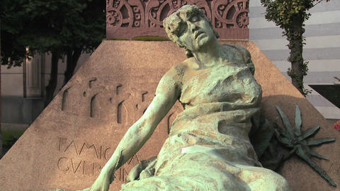 A sculpture in a cemetery seems to be suffering Stock Video Footage