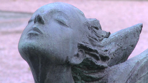 An angel sculpture in a cemetery on a grave Stock Video Footage