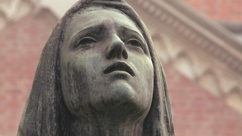 A statue of a woman weeping in a cemetery or churc Footage