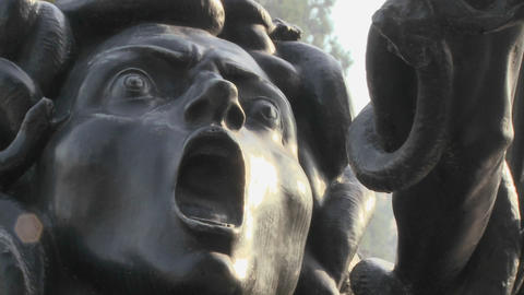 A statue of Medusa seems to be crying out in horro Stock Video Footage