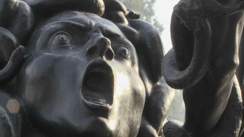 A statue of Medusa seems to be crying out in horro Footage