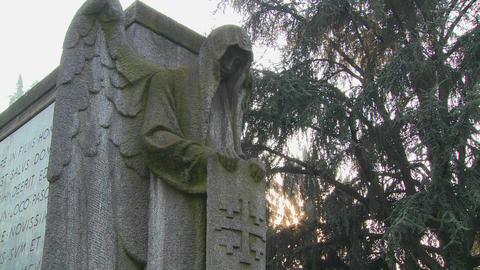 A ghostly angel looks down on a grave from above Footage