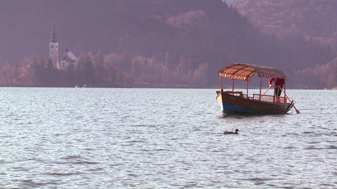 A boat passes a beautiful medieval castle and chur Stock Video Footage