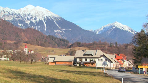 Cars drive through the countryside of Slovenia or Stock Video Footage