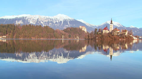 A church stands on an island at Lake Bled, Sloveni Stock Video Footage