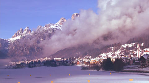 Time lapse of a distant snowbound village in the A Stock Video Footage