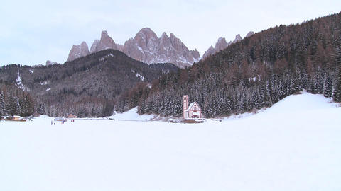 A beautiful church is nestled in the Alps Footage