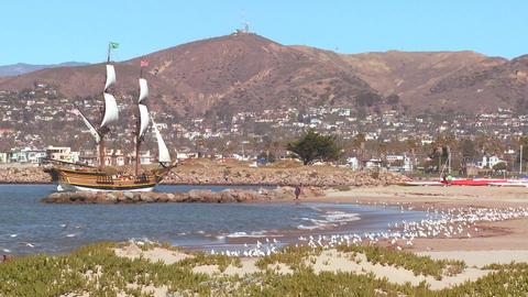 A tall master schooner sails into Ventura harbor Stock Video Footage