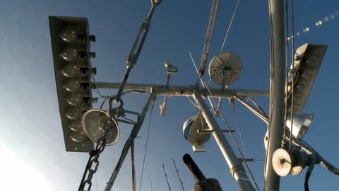 Skyward view of a fish cutters mast with equipment Footage