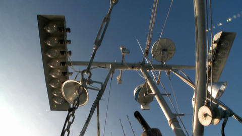 Skyward view of a fish cutters mast with equipment Stock Video Footage