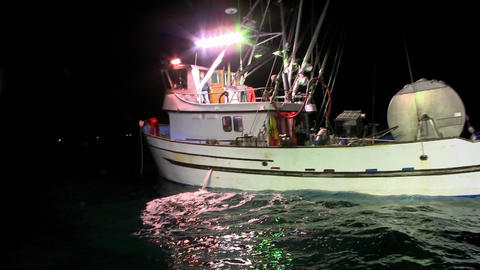 A man works on the deck of a boat, another man comes out... Stock Video Footage