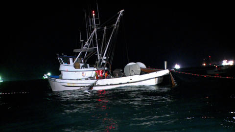 A fishing boat equipped with a net and a winch is working... Stock Video Footage