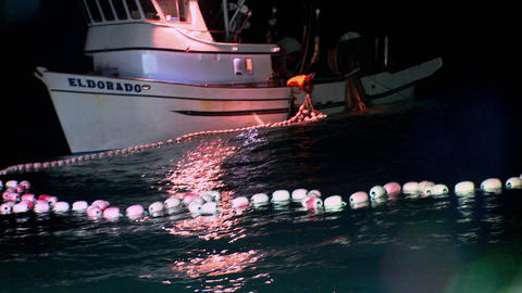 A fisherman works with nets on his fishing boat Stock Video Footage