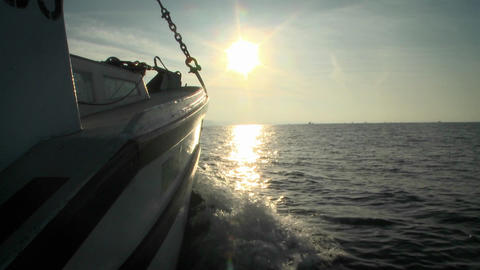 A boat sails in open waters towards the horizon Footage
