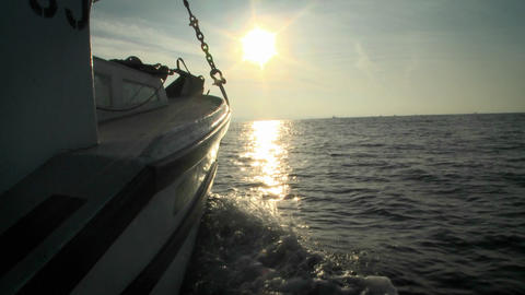 A boat sails in open waters towards the horizon Stock Video Footage