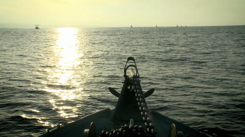 A boat travels through the water as the sun is starting... Stock Video Footage
