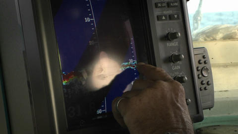 A man points with his finger on a monitor Stock Video Footage