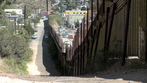 A large fence separates a border community Stock Video Footage