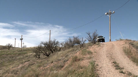 A vehicle sits on a path in a remote area Stock Video Footage