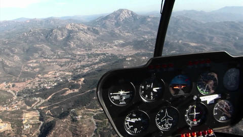 A plane flies over a mountainous area Footage