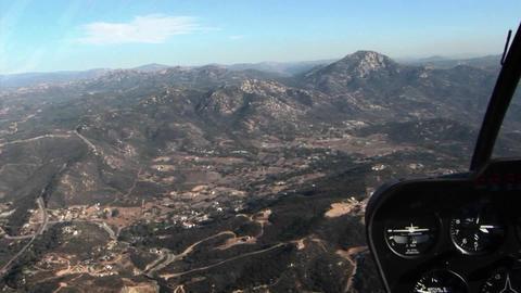 A plane flies over a mountainous area Stock Video Footage