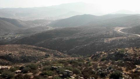 A road runs through a mountain area Footage