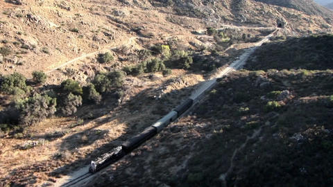 A train travels through the country side Footage
