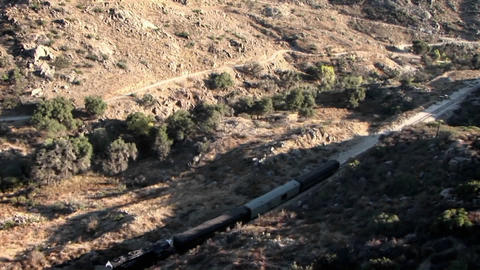A train travels through the country side Stock Video Footage