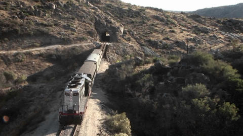 A train begins to enter into a tunnel Stock Video Footage