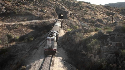 A train begins to enter into a tunnel Footage