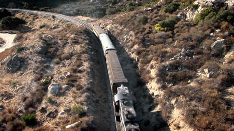 A train travels through a mountainous area Stock Video Footage