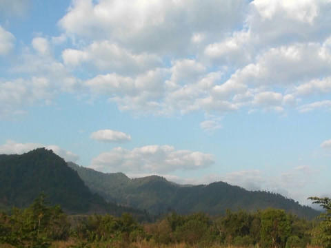 Clouds pass over a mountainous region Footage