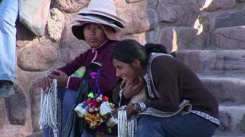 Latin American souvenir sellers hold a dog at a tourist... Stock Video Footage