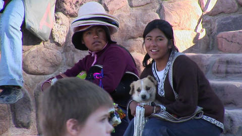 Latin American souvenir sellers hold a dog at a tourist attraction in South America Footage
