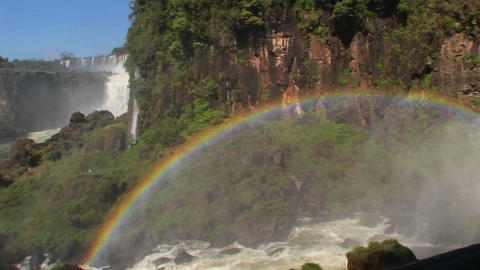 Pan across a rainbow at Iguacu Falls Stock Video Footage