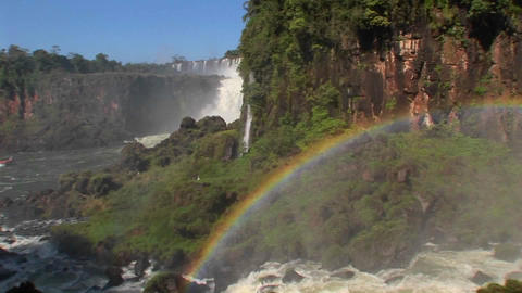 Pan across a rainbow at Iguacu Falls Footage