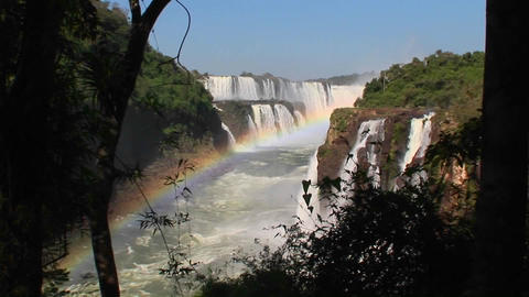 A zoom into Iguacu Falls with a rainbow in the foreground Footage