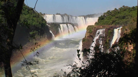 A zoom into Iguacu Falls with a rainbow in the foreground Stock Video Footage