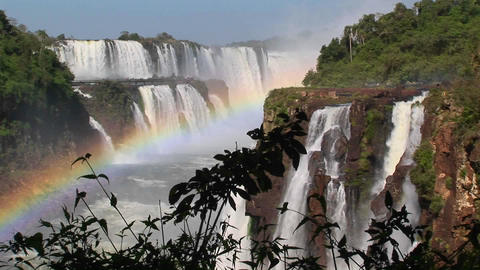 A beautiful shot of Iguacu Falls with a rainbow in the... Stock Video Footage