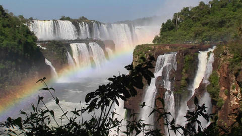 A beautiful shot of Iguacu Falls with a rainbow in the foreground Footage