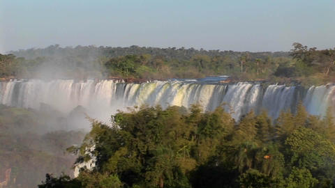 A slow pan across beautiful Iguacu Falls at the Brazil Argentina border Footage