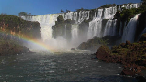 A beautiful wide shot of Iguacu Falls with a rainbow foreground Footage