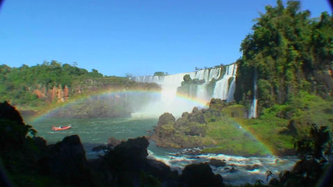 Argentina Iguazu Falls wide angle with rainbow and boat Stock Video Footage