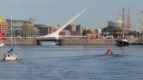 Buenos Aires harbor with sail boat and bridge Puerto Madero Footage