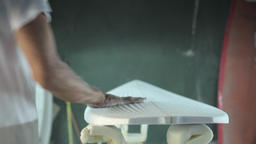 Surfboard making, Shaper examining the top of the board Footage