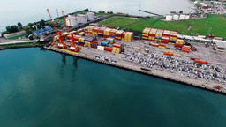 Flying over cargo port Batumi Georgia 4k aerial video. Shipping containers dock Footage