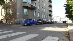 Vivid blue classic Volkswagen beetle parked on Helsinki street Footage