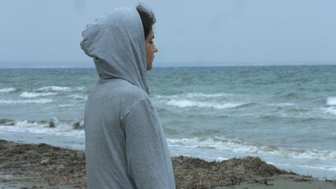 Lonely depressed woman looking at stormy sea, thinking of suicide. Broken heart Footage