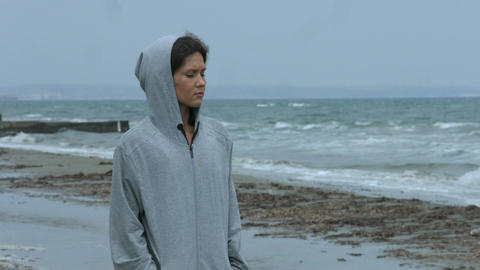 Beautiful young female feeling upset, looking at gloomy seascape, thinking Footage